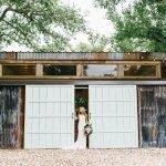 Temple Texas Wedding Venue Blue Barn Doors and bride