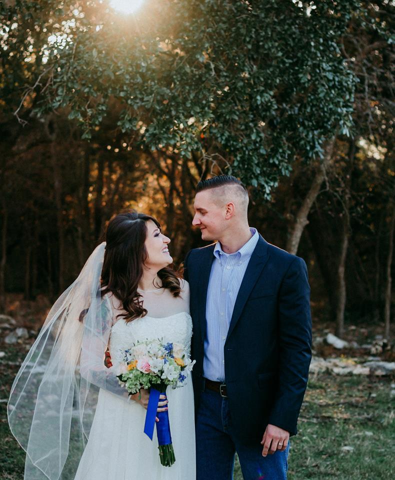 Bride & Groom in front of woods