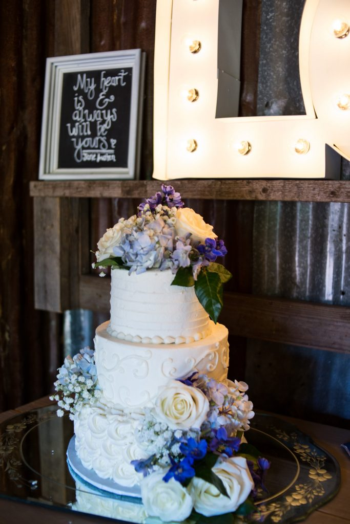Cake and flowers at temple texas wedding venue