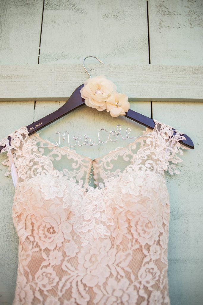Wedding Dress hanging on door Temple Texas wedding venue