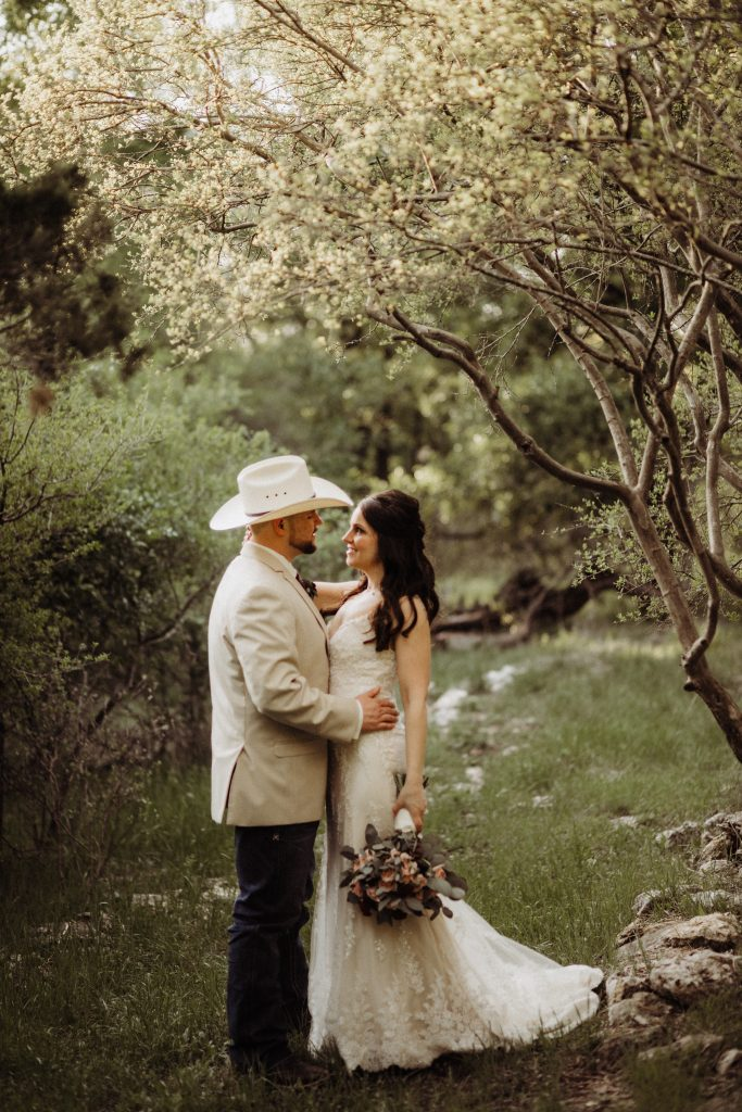 Couple in the woods at Waco Area Wedding Venue