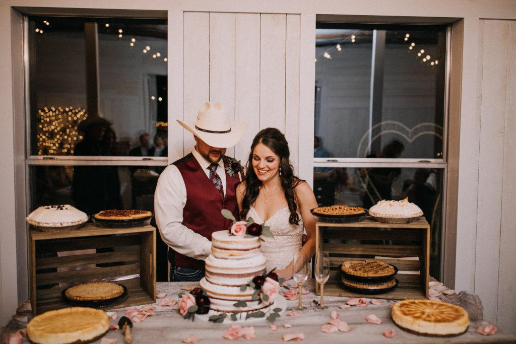 Bride and Groom cutting cake Austin Area Wedding Venue