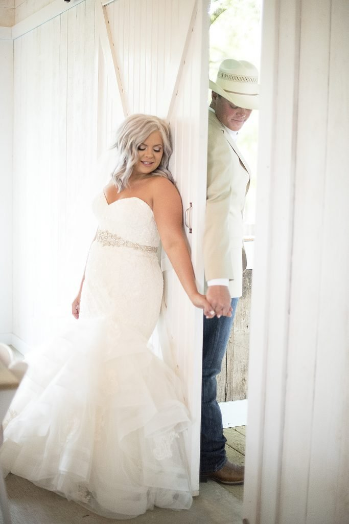 Bride and Groom having first touch Temple Texas Venue
