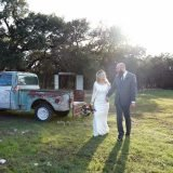 Bride and Groom walking by truck Temple texas Wedding Venue