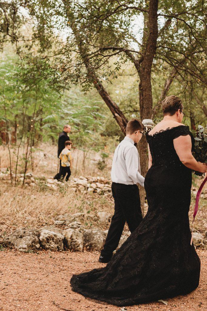 bride escorted by son