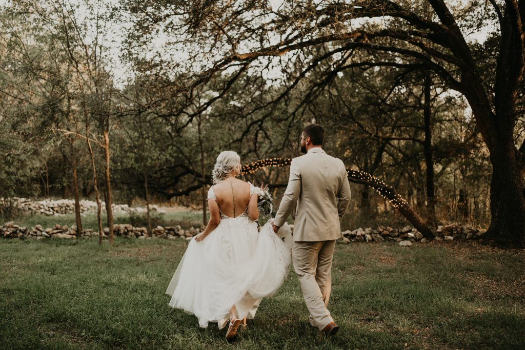couple walking in Texas woods