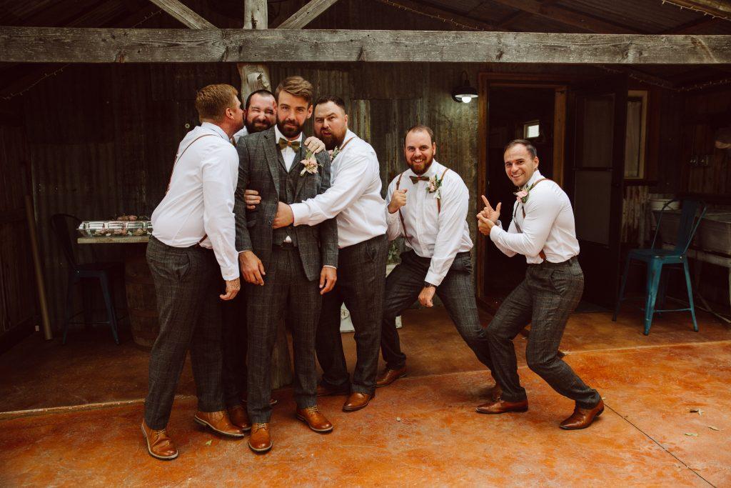 Groom and groomsmen having fun