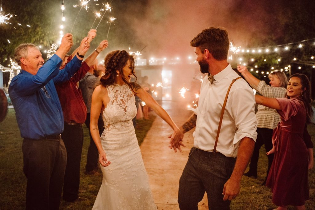 Bride and groom with fun sparkler send-off Temple Texcas
