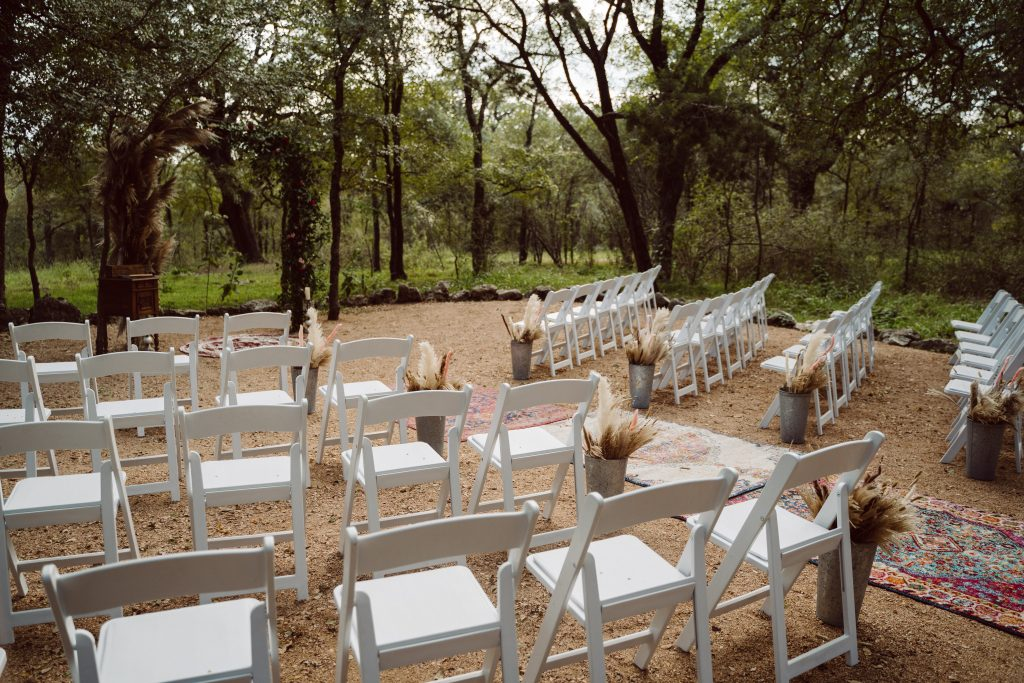 Boho Ceremony set up in woods Temple texas wedding venue