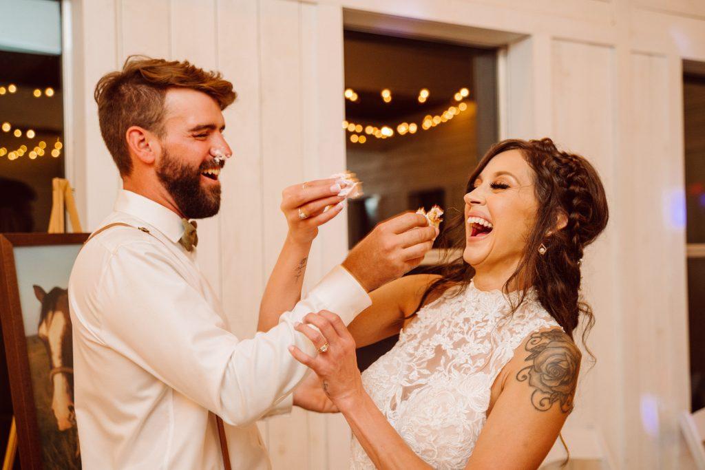 Bride and Groom eat wedding cake