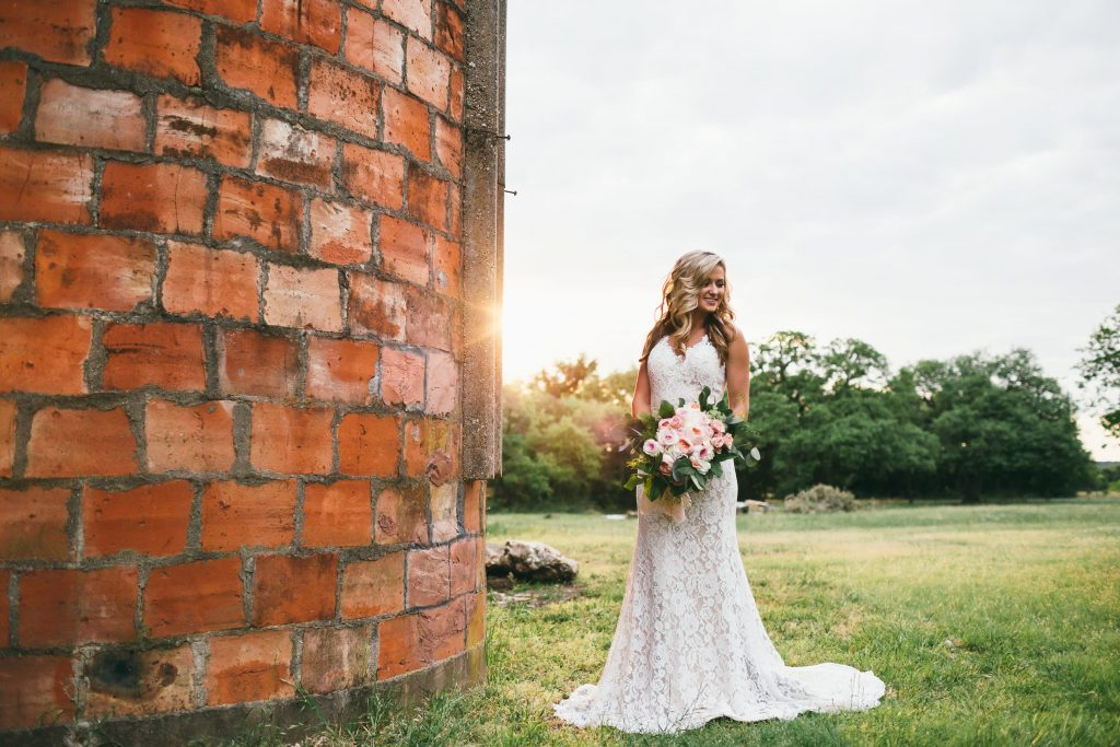Bride at sunset by the Silo at Temple Tx Wedding Venue