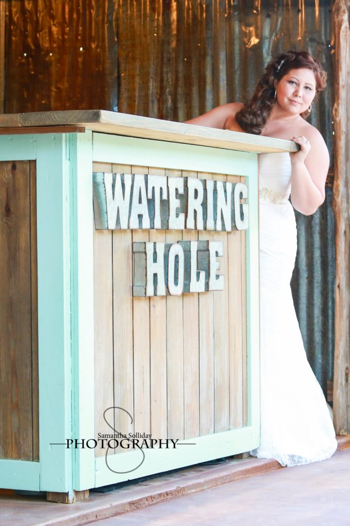 bride standing by watering hole