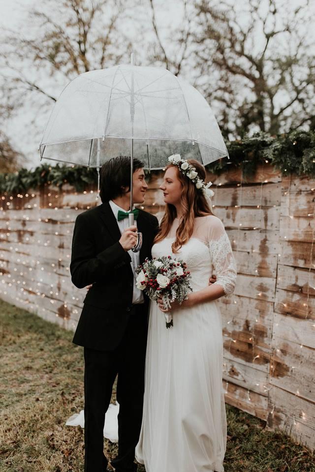Couple in rain Temple Texas Wedding venue