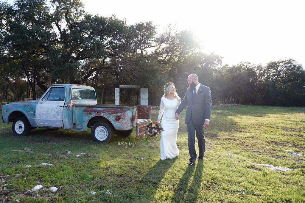 Bride and Groom walking by truck Temple texas Wedding Venue