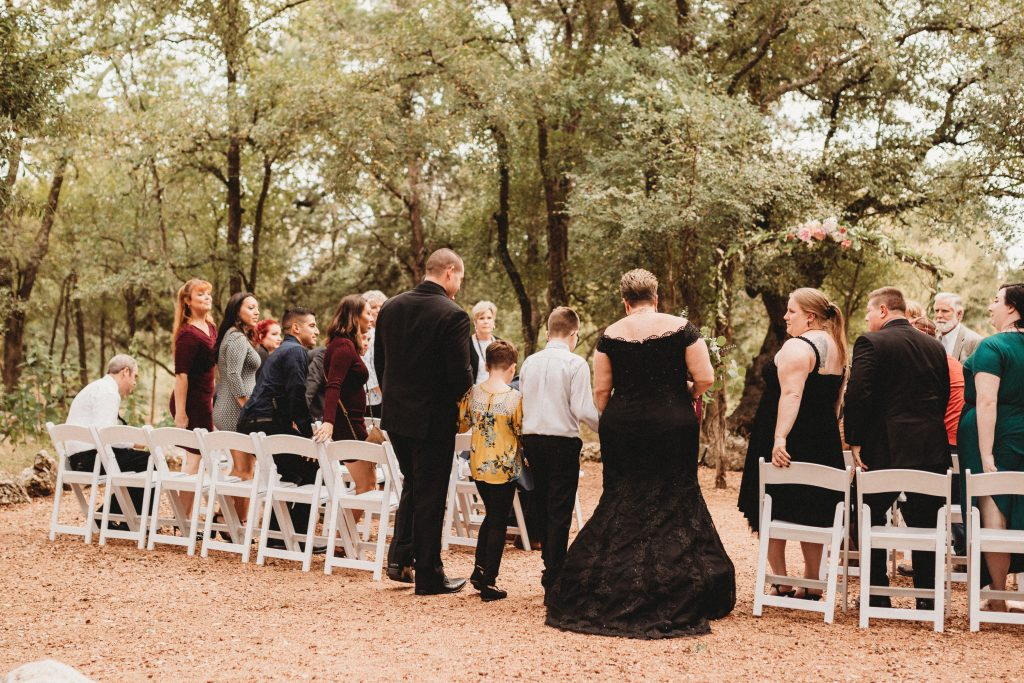 family walking up the aisle