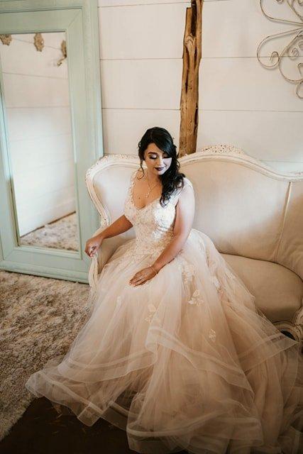 Bride on settee temple, texas wedding venue
