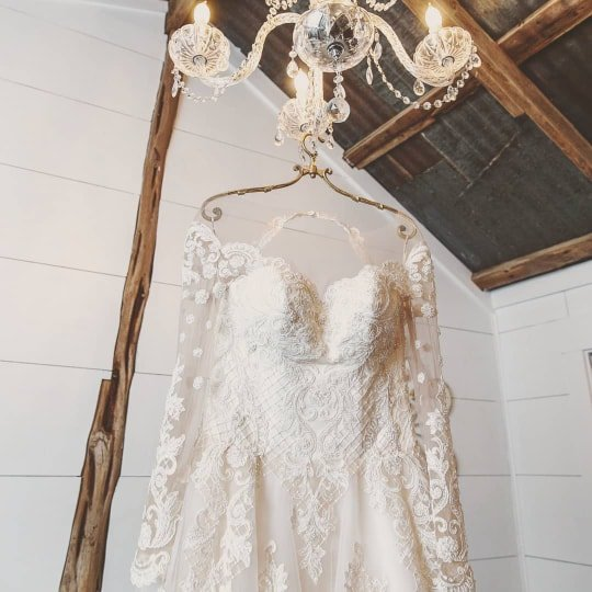 wedding dress hanging from chandelier temple tx