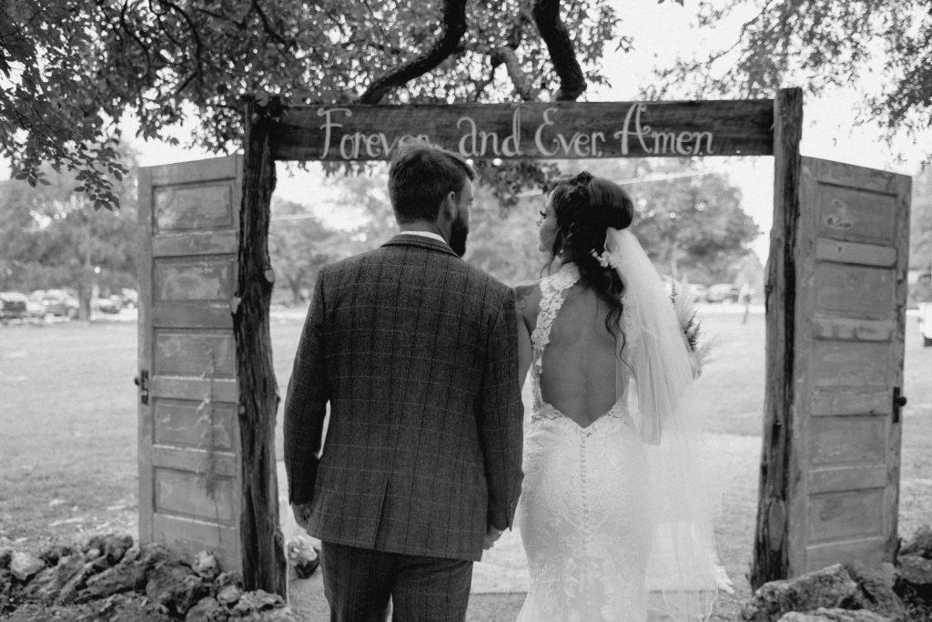 The couple walking through doorway