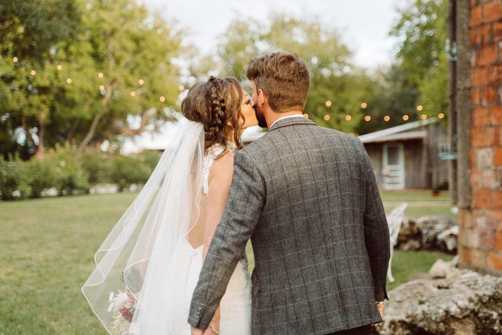 Bride kisses groom's cheek