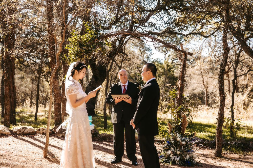 couple exchanging vows at elopement ceremony