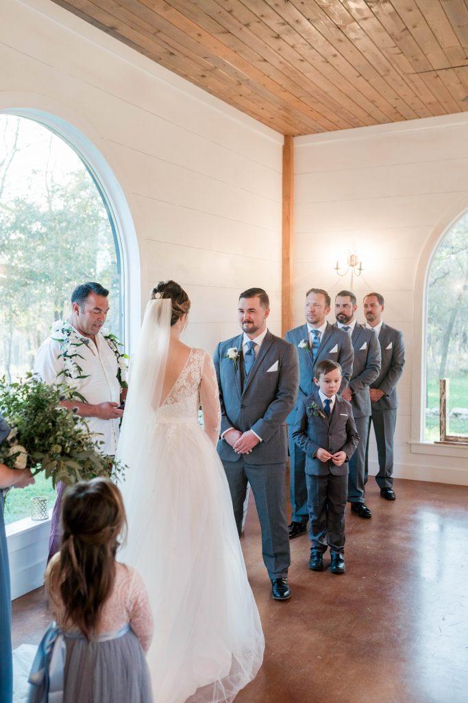 bride and groomsmen at altar